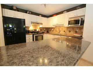 """Photo 6: 110 888 GAUTHIER Avenue in Coquitlam: Coquitlam West Condo for sale in """"LA BRITTANY"""" : MLS®# V1074364"""