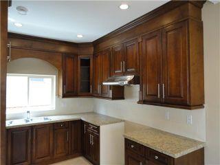 Photo 4: 8455 OAK Street in Vancouver: Marpole 1/2 Duplex for sale (Vancouver West)  : MLS®# V835242