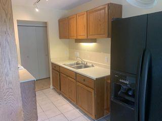 Photo 4: 5 2319 19 Street: Nanton Apartment for sale : MLS®# A1129616