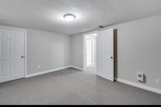 Photo 25: 29 Somme Boulevard SW in Calgary: Garrison Woods Row/Townhouse for sale : MLS®# A1129180