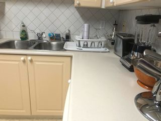 """Photo 9: 411 8142 120A Street in Surrey: Queen Mary Park Surrey Condo for sale in """"STERLING COURT"""" : MLS®# R2606103"""