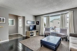 Photo 3: 207 STRATHEARN Crescent SW in Calgary: Strathcona Park House for sale : MLS®# C4165815