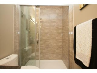 Photo 14: 224 SUNTERRA RIDGE Place: Cochrane Residential Detached Single Family for sale : MLS®# C3633482