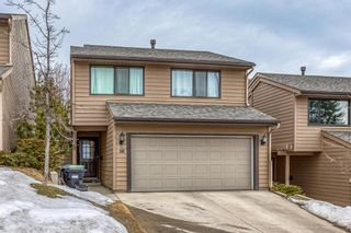 Photo 10: 10 Coach  Manor Rise SW in Calgary: Coach Hill Row/Townhouse for sale : MLS®# A1077472