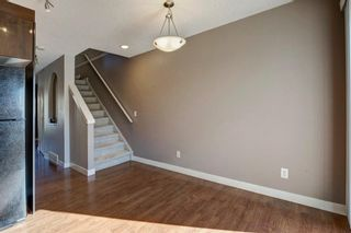 Photo 10: 106 2445 Kingsland Road SE: Airdrie Row/Townhouse for sale : MLS®# A1072510