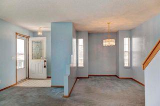 Photo 4: 254 SARATOGA Close NE in Calgary: Monterey Park House for sale : MLS®# C4165371