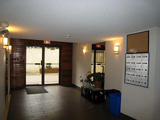 "Main Photo: 203 1296 W 70TH Avenue in Vancouver: Marpole Condo for sale in ""MARPOLE OAKS"" (Vancouver West)  : MLS®# V1033077"