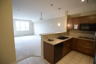 Photo 18: 204 26 VAL GARDENA View SW in Calgary: Springbank Hill Apartment for sale : MLS®# A1045498