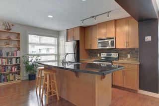 Photo 8: 120 ASPEN HILLS Villa SW in Calgary: Aspen Woods Row/Townhouse for sale : MLS®# C4242646