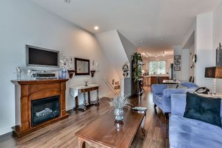 """Photo 7: 105 3010 RIVERBEND Drive in Coquitlam: Coquitlam East Townhouse for sale in """"WESTWOOD"""" : MLS®# R2109754"""