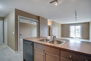 Photo 4: 1208 92 Crystal Shores Road: Okotoks Apartment for sale : MLS®# A1089465