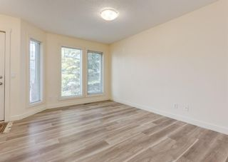 Photo 4: 402 2445 Kingsland Road SE: Airdrie Row/Townhouse for sale : MLS®# A1107683