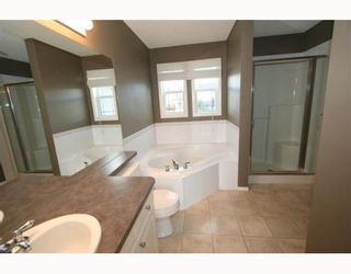 Photo 11: 11323 ROCKYVALLEY Drive NW in CALGARY: Rocky Ridge Ranch Residential Detached Single Family for sale (Calgary)  : MLS®# C3360614