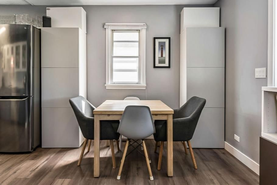The dining space is well thought out with extra storage cabinets.