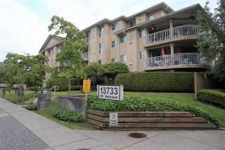 "Photo 1: 205 13733 74 Avenue in Surrey: East Newton Condo for sale in ""KINGS COURT"" : MLS®# R2465074"