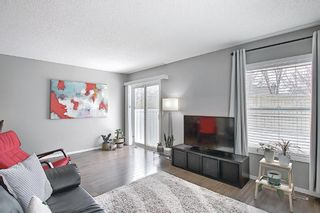 Photo 7: 101 Country Hills Villas NW in Calgary: Country Hills Row/Townhouse for sale : MLS®# A1089645