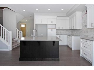 Photo 12: 158 WALGROVE Drive SE in Calgary: Walden House for sale : MLS®# C4075055