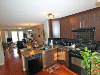 Photo 3: 203 2445 KINGSLAND Road SE: Airdrie Townhouse for sale : MLS®# C3603251