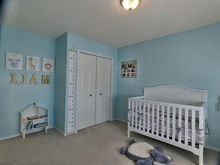 Photo 19: 12 Sienna Heights Way SW in Calgary: Signal Hill Detached for sale : MLS®# A1099178