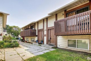 Photo 2: 8 7630 Ogden Road SE in Calgary: Ogden Row/Townhouse for sale : MLS®# A1130007