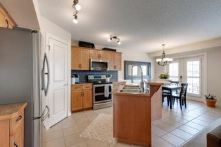 Photo 8: 198 Cougar Plateau Way SW in Calgary: Cougar Ridge Detached for sale : MLS®# A1133331
