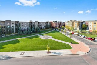 Photo 2: 8403 304 Mackenzie Way: Airdrie Apartment for sale : MLS®# A1146361