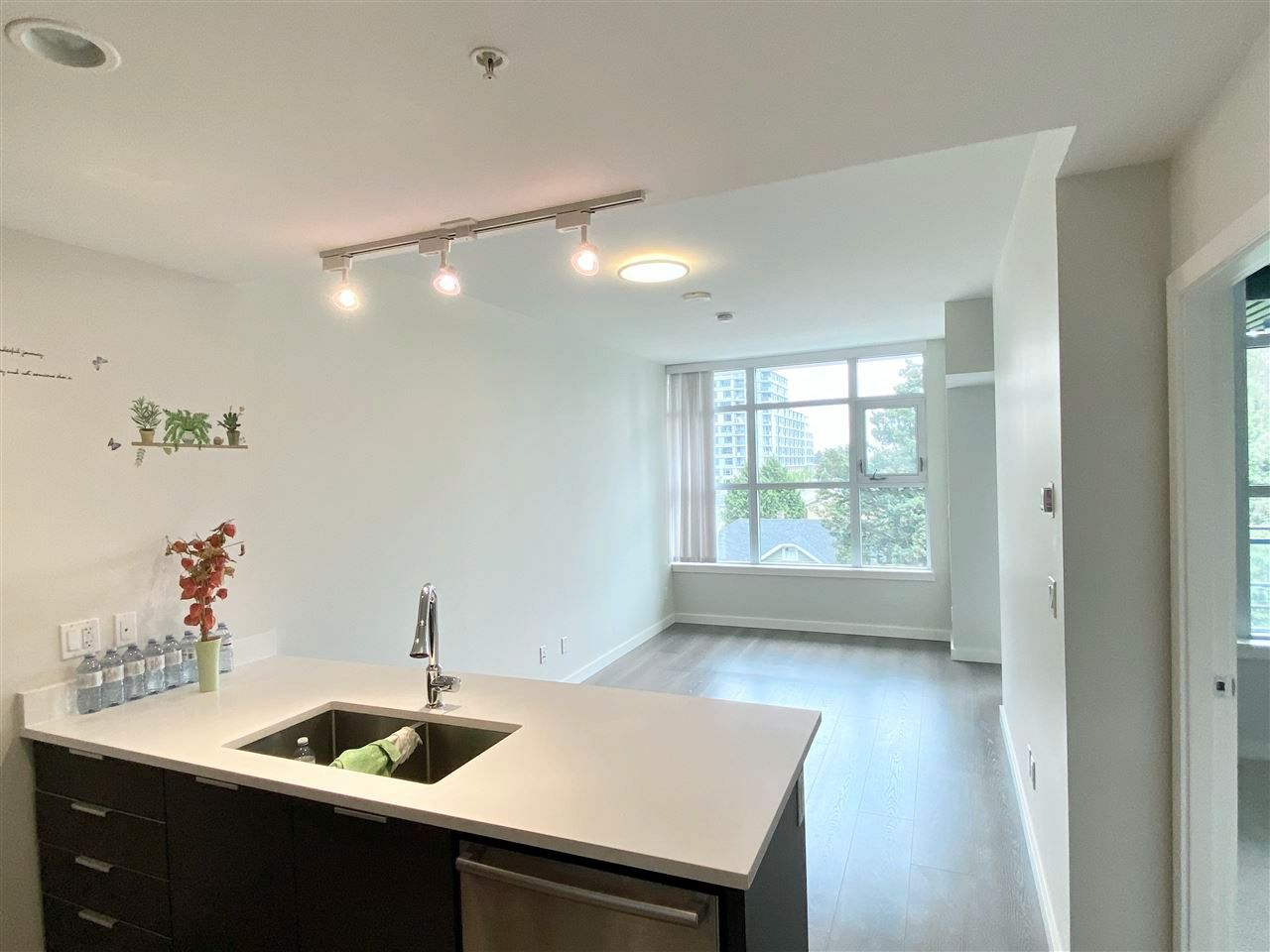 Main Photo: 513 3333 SEXSMITH Road in Richmond: West Cambie Condo for sale : MLS®# R2570934