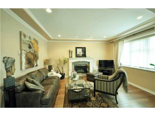 Photo 3: 7871 CUMBERLAND ST - LISTED BY SUTTON CENTRE REALTY in Burnaby: East Burnaby House for sale (Burnaby East)  : MLS®# V1102281