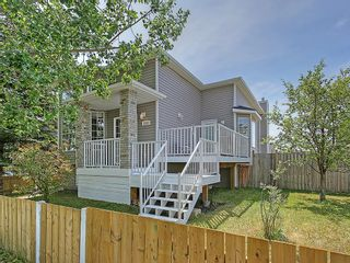 Photo 1: 1103 THORBURN Drive SE: Airdrie House for sale