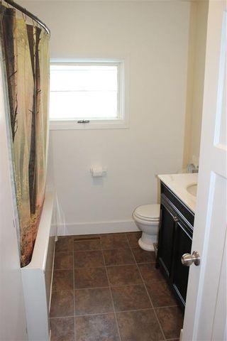 Photo 31: 1014 Nanton Avenue: Crossfield Detached for sale : MLS®# C4281376