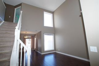 Photo 4: 117 Coverdale Road NE in Calgary: Coventry Hills Detached for sale : MLS®# A1075878