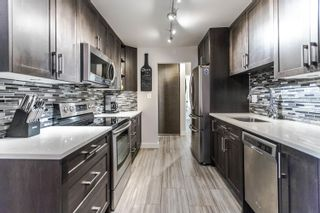 "Photo 1: 103 1935 W 1ST Avenue in Vancouver: Kitsilano Condo for sale in ""KINGSTON GARDENS"" (Vancouver West)  : MLS®# R2249409"