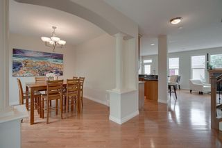 Photo 3: 212 Somme Avenue SW in Calgary: Garrison Woods Row/Townhouse for sale : MLS®# A1129738