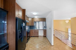 Photo 13: 128 Dovertree Place SE in Calgary: Dover Semi Detached for sale : MLS®# A1075565