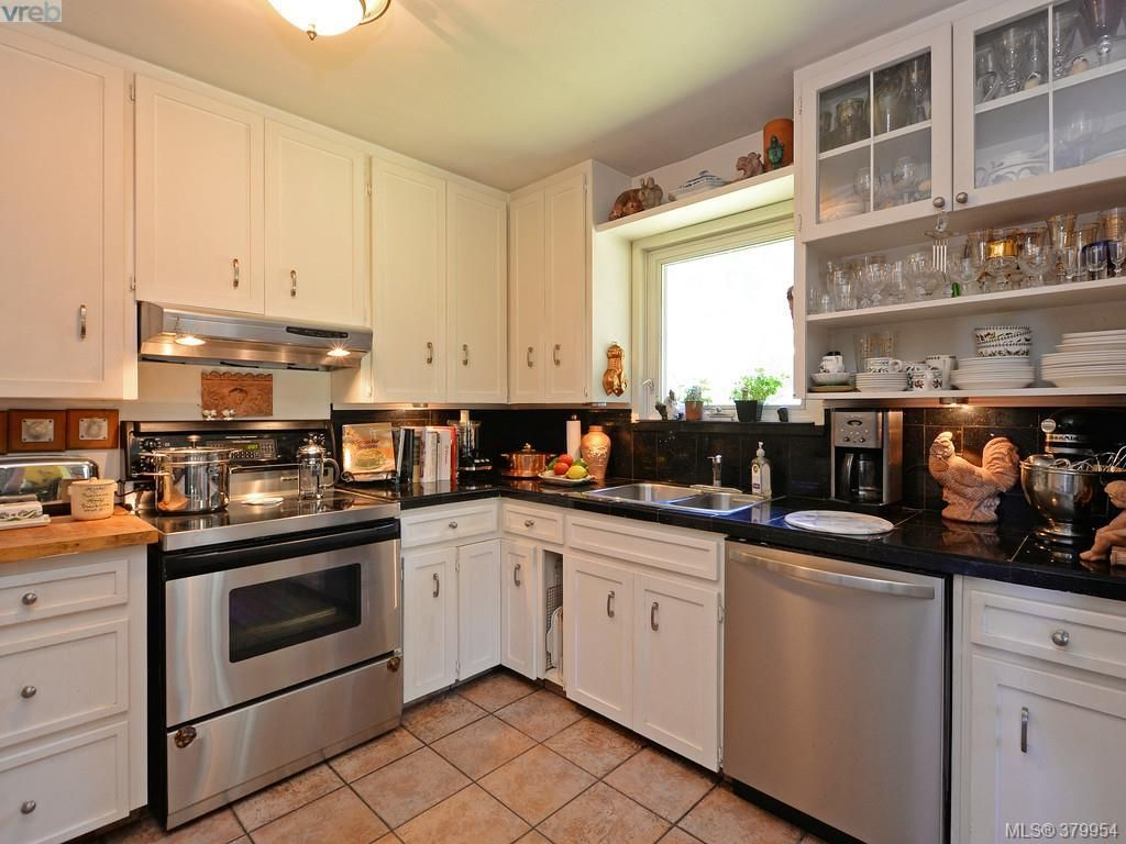 Updated kitchen with stainless appliances, granite counters and ceramic tile flooring.