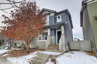 Photo 1: 157 Eversyde Boulevard SW in Calgary: Evergreen Semi Detached for sale : MLS®# A1055138