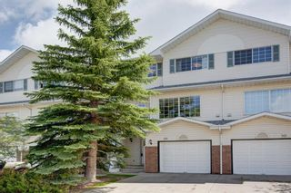 Photo 1: 26 Lincoln Green SW in Calgary: Lincoln Park Row/Townhouse for sale : MLS®# A1069868