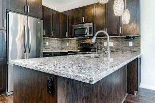 "Photo 2: 201 6480 194 Street in Surrey: Clayton Condo for sale in ""WATERSTONE - ESPLANADE"" (Cloverdale)  : MLS®# R2379368"