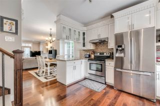 """Photo 9: 119 3333 DEWDNEY TRUNK Road in Port Moody: Port Moody Centre Townhouse for sale in """"CENTRE POINT"""" : MLS®# R2408387"""