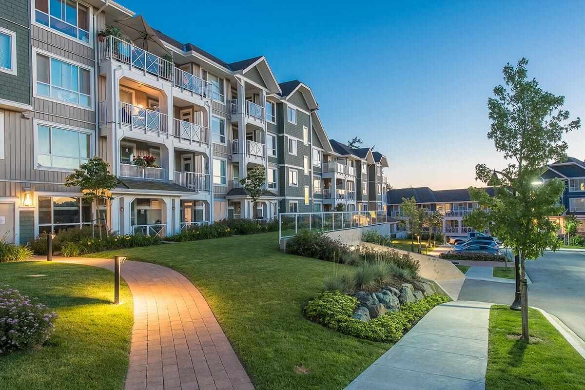"""Main Photo: 112 16398 64 Avenue in Surrey: Cloverdale BC Condo for sale in """"THE RIDGE AT BOSE FARMS"""" (Cloverdale)  : MLS®# R2590221"""