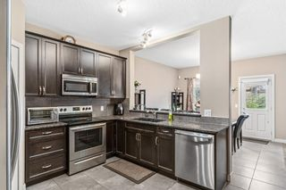 Photo 8: 121 Everhollow Rise SW in Calgary: Evergreen Detached for sale : MLS®# A1146816