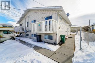 Photo 1: 4912 56 Street in Innisfail: Multi-family for sale : MLS®# A1096915
