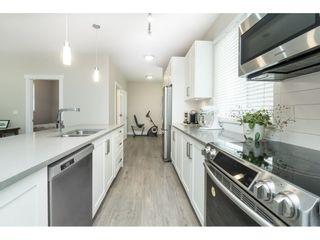 "Photo 13: 102 218 BEGIN Street in Coquitlam: Maillardville Townhouse for sale in ""Begin Square"" : MLS®# R2504206"