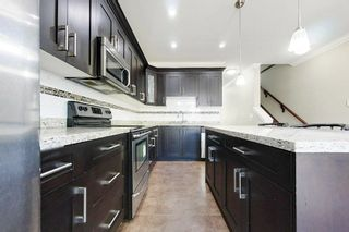 """Photo 17: 77 6383 140 Street in Surrey: Sullivan Station Townhouse for sale in """"PANORAMA WEST VILLAGE"""" : MLS®# R2573308"""
