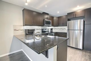 Photo 5: 309 WINDFORD Green SW: Airdrie Row/Townhouse for sale : MLS®# A1131009