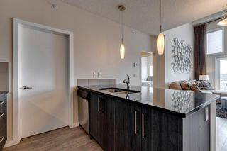 Photo 4: 404 402 Marquis Lane SE in Calgary: Mahogany Apartment for sale : MLS®# A1131322