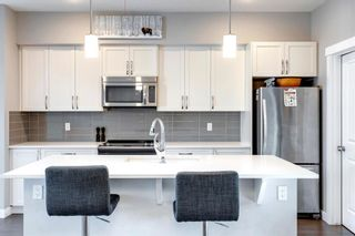 Photo 6: 971 Nolan Hill Boulevard NW in Calgary: Nolan Hill Row/Townhouse for sale : MLS®# A1114155