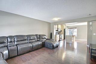 Photo 5: 3326 New Brighton Gardens SE in Calgary: New Brighton Row/Townhouse for sale : MLS®# A1077615