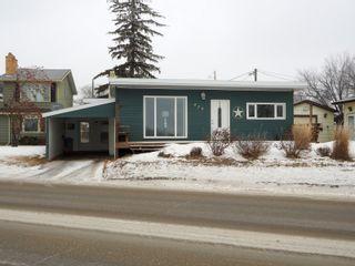Photo 1: 425 Crescent Road E in Portage la Prairie: House for sale : MLS®# 202101949