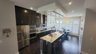 Main Photo: 2138 52 Avenue SW in Calgary: North Glenmore Park Semi Detached for sale : MLS®# A1130381